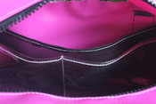 """Inside pockets. Large mesh pocket full length of the bag and two clear plastic pockets half the size of the side.  """"Total of 6 inside pockets."""