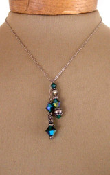 Long chain lariat necklace with green beads on end