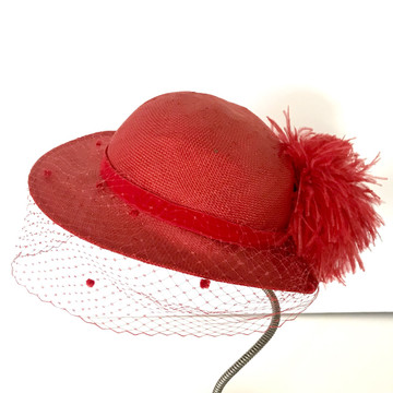 Red woven hat with veil and feather pom pom
