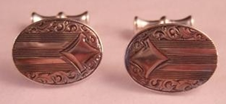 Silver oval cuff links with stripe and scroll