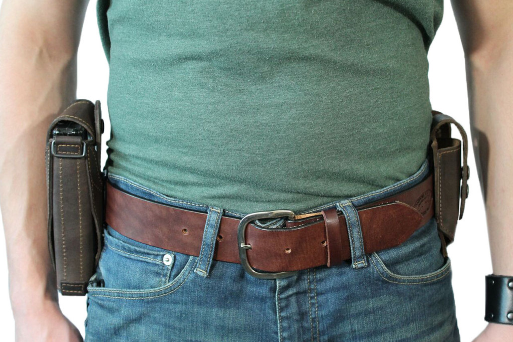 leather ambidextrous holster with magazine pouch on belt