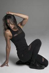 Rendezvous Yoga Tank in Black Lifestyle Shot Sitting