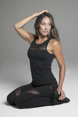 Rendezvous Yoga Tank Top in Black Sitting Lifestyle Shot