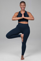 yoga bra and legging in tree pose