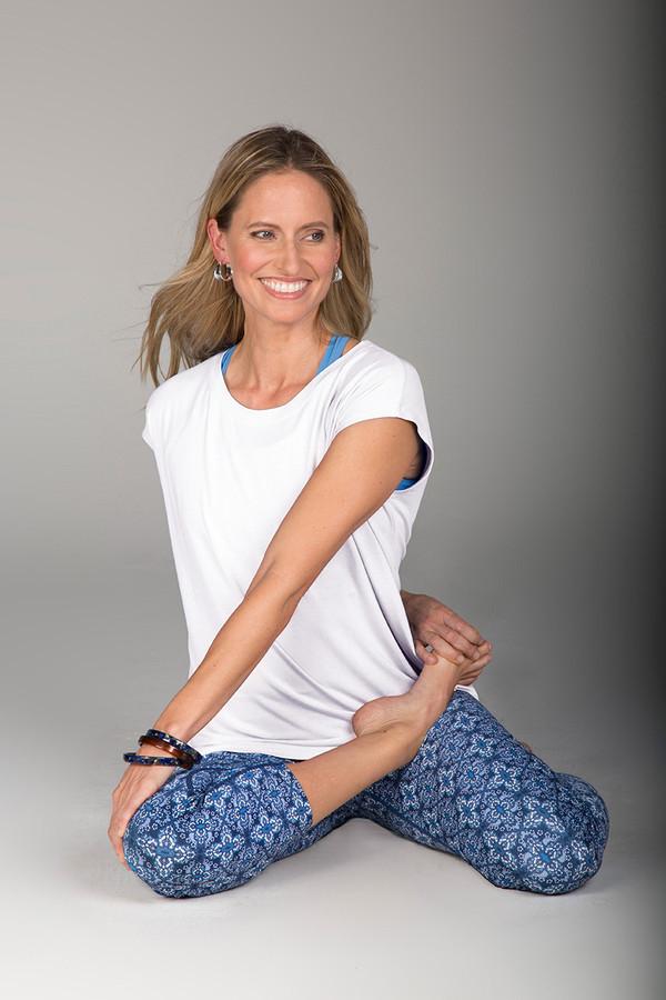 White T-Shirt and Blue Print Capri Set Yoga Pose
