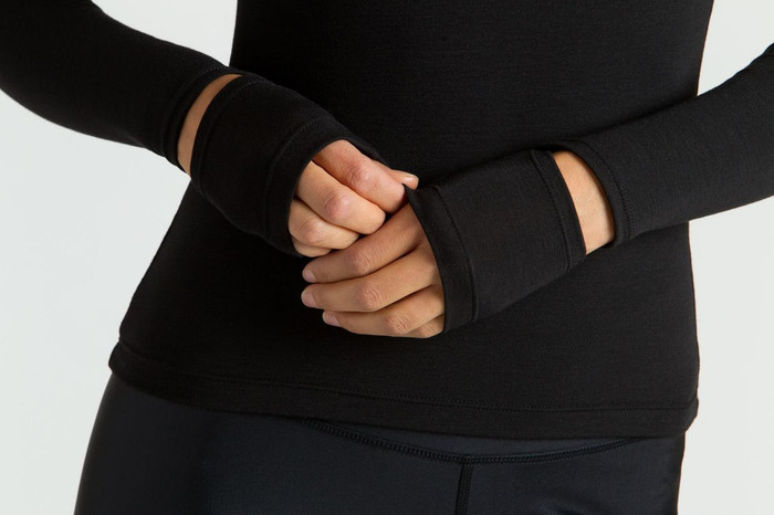 KiraGrace Cut-Out Sleeve yoga Top in black close up of cut out detailing at wrists