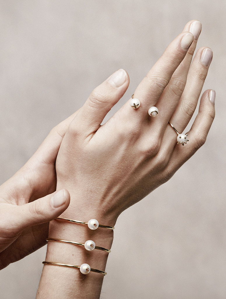Model wearing Cultured Freshwater Pearl Ring with 14k Gold Spikes and Band by Jewelry Designer Nektar De Stagni