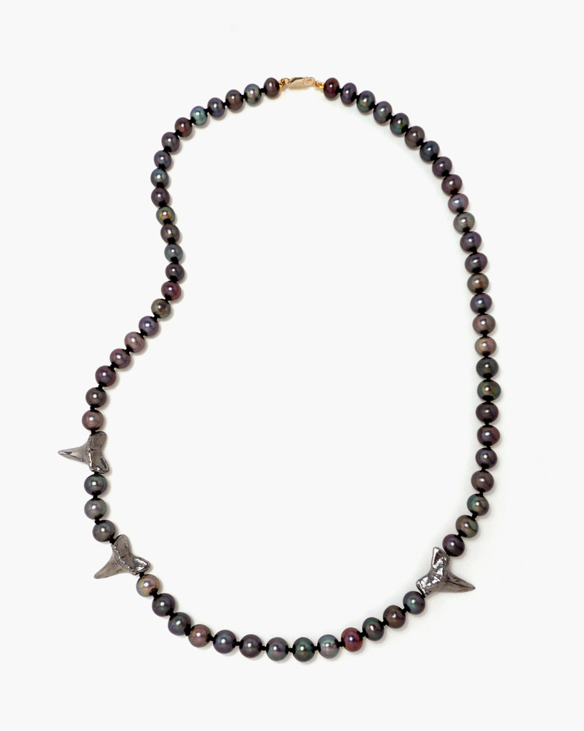 Black Peacock Cultured Pearl Necklace with Cruelty-Free Gold Black Rhodium Dipped Shark Teeth. by Fine Jewelry Designer Nektar De Stagni.