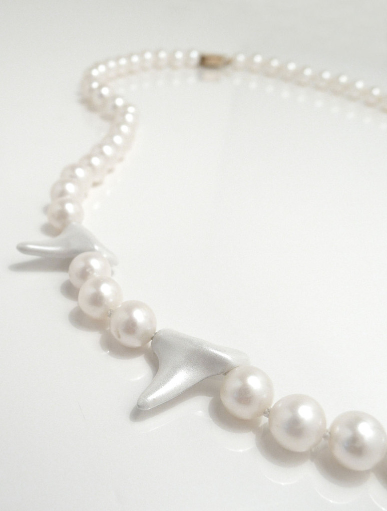 Close up of Shark Teeth & Pearl Necklace by Fine Jewelry Designer Nektar De Stagni