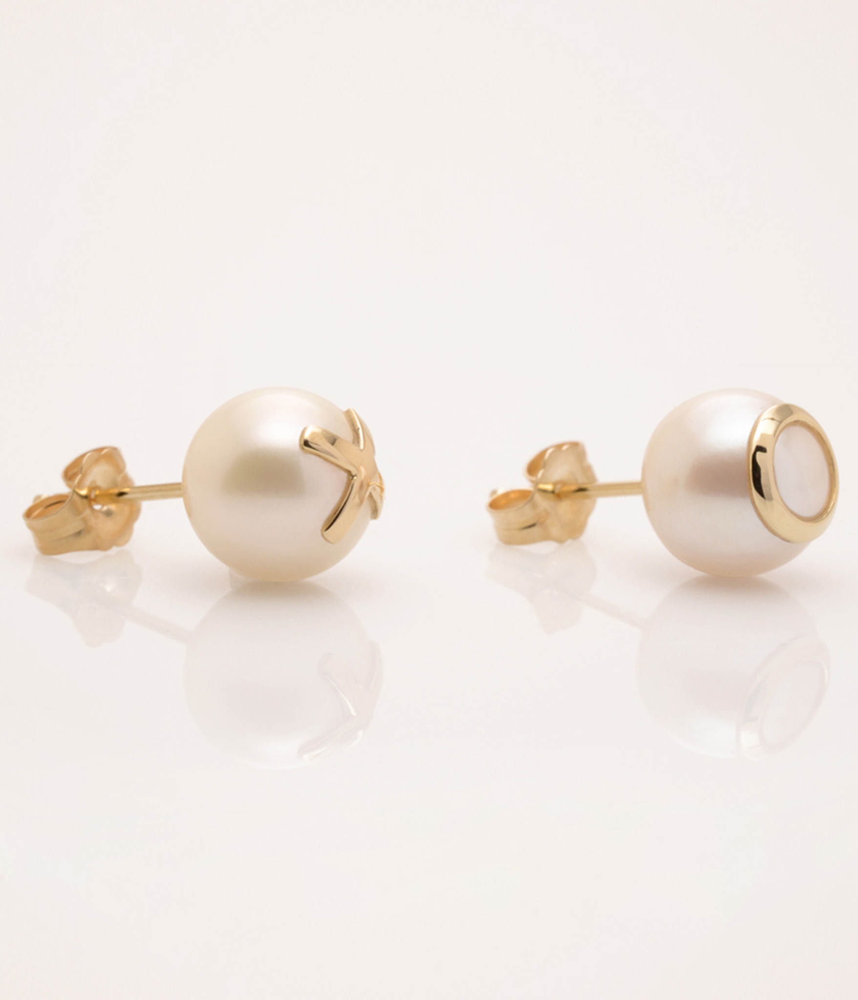 Side view of Cultured Freshwater Pearl Earrings with 14k Gold XO Emoji (8-9 mm) by Nektar De Stagni