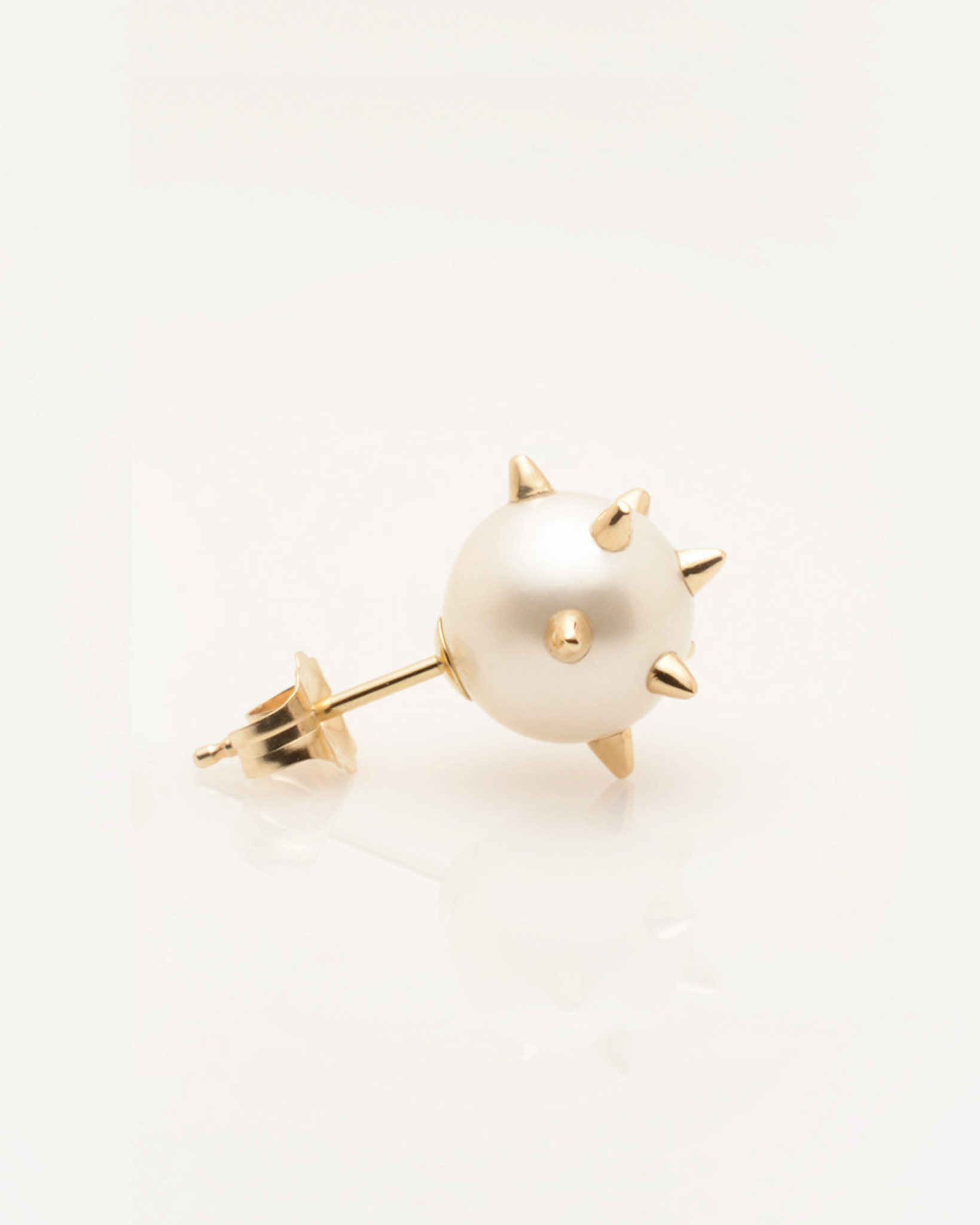 Side View of Single Cultured Freshwater Pearl Earring with 14k Gold Spikes & Post by Jewelry Designer Nektar De Stagni (8-9mm)