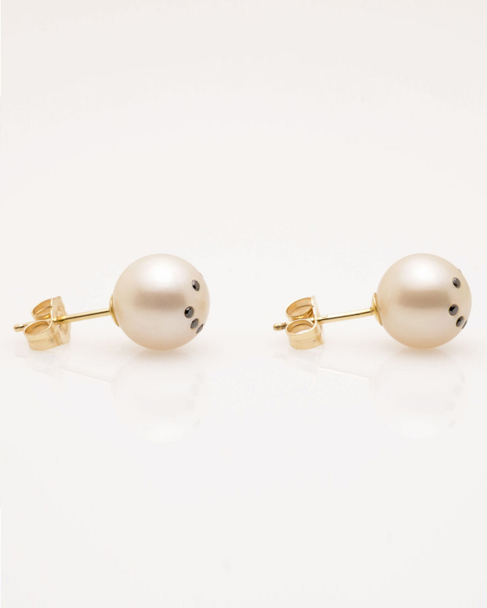 Side view of Cultured Freshwater Pearl Earrings with Smiley Emoji Diamond Pavè & 14k Gold Posts (8-9 mm) by Jewelry Designer Nektar De Stagni