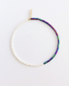 An understated modern bead necklace and bracelet jewelry collection designed by Nektar De Stagni. This minimal design, pairs colorful Hematite Beads and delicate Cultured Freshwater Seed Pearls.