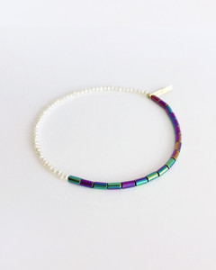 Side View of  Jewelry Designers Nektar De Stagni colorful stretch friendship bracelet, featuring Hematite Beads and delicate Cultured Freshwater Seed Pearls.