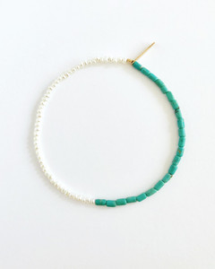 This design, pairs colorful Turquoise Beads and delicate Cultured Freshwater Seed Pearls. Part of an understated modern bead necklace and bracelet jewelry collection designed by Nektar De Stagni.