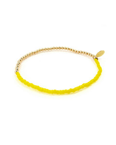 Side view if Gold Bead & Bright Yellow Glass Bead Friendship Bracelet by Jewelry Designer Nektar De Stagni
