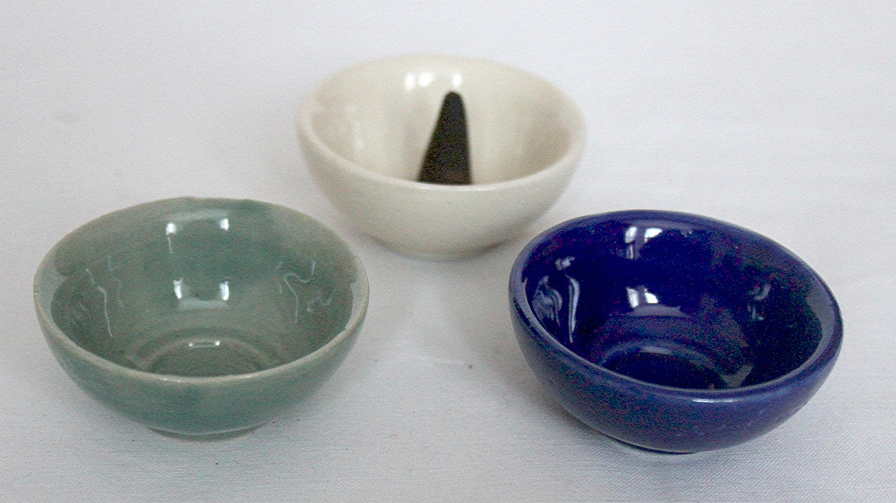 incense cones in ceramic burner