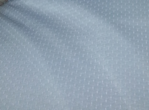 Closeup of poly mesh texture.  Our Queen and King mattress pad Covers provide more temperature regulation with no electricity. Cooling your bed in the summer and warming in the winter , it adjusts for seasonal and climate changes.