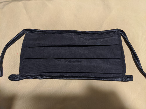 "Black  cooling mask that ties around the ears using the bottom loop. Width is 8-9""  The top tie is 9"" It threads through the bottom loop to adjust around the ears."