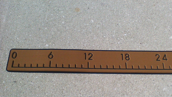"Measure stick 36"" teak over black"