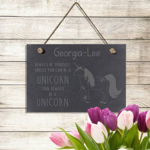 This hanging slate sign measures 18cm wide and 13cm tall and would make the perfect addition to any unicorn lovers home. Personalise with your chosen name of 15 characters, written above the quote 'ALWAYS BE YOURSELF UNLESS YOU CAN BE A UNICORN, THEN ALWAYS BE A UNICORN'.