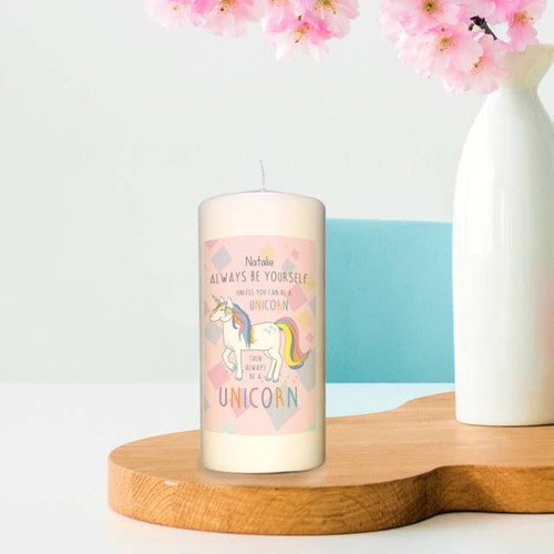 "The ivory candle stands 6"" tall and is approx. 3"" in diameter. Personalise with your chosen name of 15 characters, written above the quote 'ALWAYS BE YOURSELF UNLESS YOU CAN BE A UNICORN, THEN ALWAYS BE A UNICORN'. It is presented in clear wrapping and finished off with a hand-tied ribbon."
