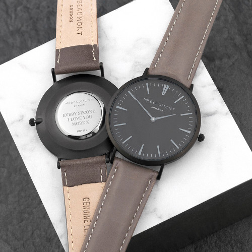 These beautiful modern-vintage watches by Mr Beaumont are carefully personalised by our craftsmen to create the ultimate gift for him.  Mr Beaumont watches are modern in design but with classic, timeless touches - making them a gift that will stand the test of time. Made from genuine leather and with a large 41mm dial with metalic silver details this watch certainly makes a statement.  Personalise the watch on the reverse with a message up to 5 lines. The message is carefully engraved onto the back of the watch, meaning your special message will forever be remembered.  The watch is beautifully presented in Mr Beaumont's trademark gift box and leather watch protector.  Case Width: 41 mm Case Depth: 6mm Overall Width: 23.5 cm