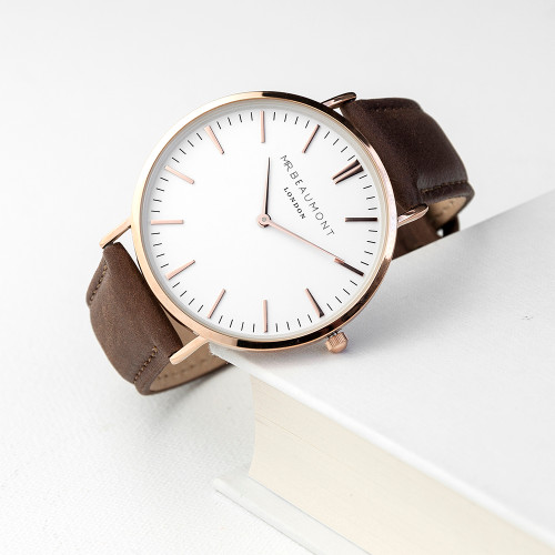 These beautiful modern-vintage watches by Mr Beaumont are carefully personalised by our craftsmen to create the ultimate gift for him.  Mr Beaumont watches are modern in design but with classic, timeless touches - making them a gift that will stand the test of time. Made from genuine leather and with a large 41mm dial with rose gold plated details this watch certainly makes a statement.  Personalise the watch on the reverse with a message up to 5 lines. The message is carefully engraved onto the back of the watch, meaning your special message will forever be remembered.  The watch is beautifully presented in Mr Beaumont's trademark gift box and leather watch protector.  Case Width: 41 mm Case Depth: 6mm Overall Width: 23.5 cm