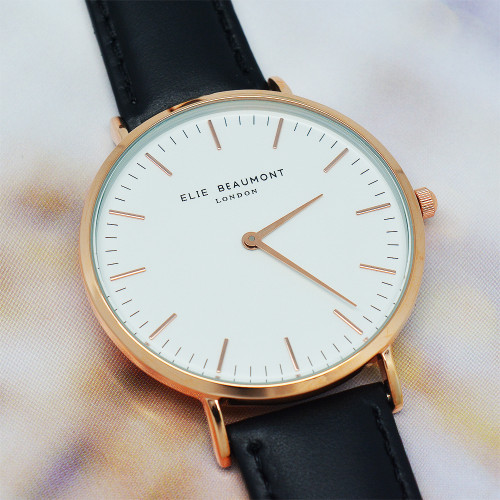 These beautiful modern-vintage watches by Elie Beaumont are carefully personalised by our craftsmen to create the ultimate gift for her.  Elie Beaumont watches are modern in design but with classic, timeless touches - making them a gift that will stand the test of time. Made from genuine leather and with a large 38mm dial with rose gold details this watch certainly makes a statement.  Personalise the watch on the reverse with a message up to 5 lines. The message is carefully engraved onto the back of the watch, meaning your special message will forever be remembered.  The watch is beautifully presented in Elie Beaumont's trademark gift box and leather watch protector.  Case Width: 38 mm Case Depth: 6mm Overall Width: 23 cm