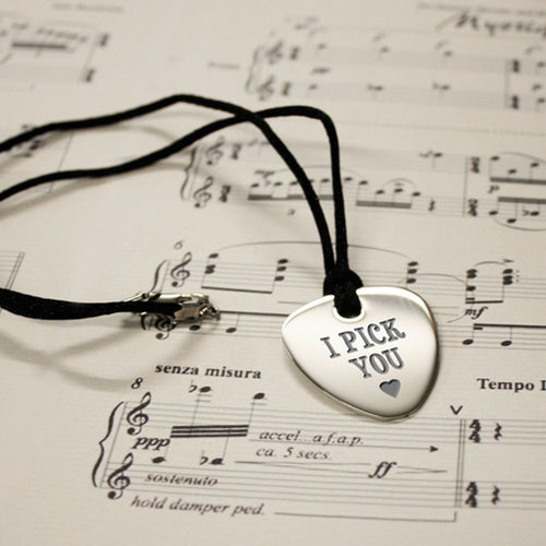 Show him that he is the one for you with this fun and original Plectrum Pendent.You are able to personalise this Plectrum Pendent with whatever you desire, making this a truly romantic and thoughtful gift. He will be able to wear this pendent with pride knowing that you personalised it just for him.Made from highly polished stainless steel this pendent is hardwearing, and has a beautiful finish.Dimensions: (Height) 3cm x (Width at widest) 2.7cm