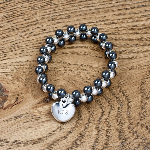 Personalised bracelet made from Hematite with curved silver plated heart. Can be personalised with up to three characters. Hematite is well known to help sooth stress and tension and draw out negativity.