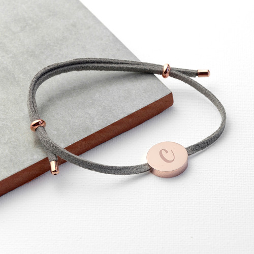Every piece of jewellery tells a story  Tell your own story with this beautifully soft suede, delicate dove grey bracelet, with a rose gold plated charm.  The bracelet is personalised with one initial & a choice of three fonts.