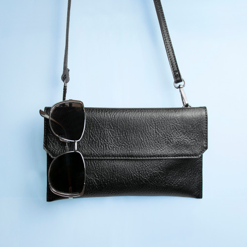 This beautifully crafted clutch bag is made from genuine leather and is delightfully soft to the touch. The bag has two straps, a hand strap and a long shoulder strap - both can be removed easily with the handy clips. Magnetic buttons make opening and closing the bag simple. The bag also has a convenient zip on the rear, perfect for her to store essentials with easy access.  The bag can be personalised on the inside panel with a message up to 90 characters - making it ideal for a special message of love, congratulations or just because.  The bag makes an excellent gift for a mum, friend, bridesmaid, girlfriend or wife. Each time she opens her gift she'll see the special message and know just how much she's loved.  Dimensions of Strap: Shoulder strap at its longest: 110cm Shoulder strap at its shortest: 100cm Wrist Strap: 18cm