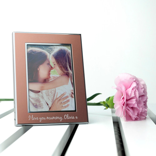 Only photograph what you love!  This beautiful rose gold coloured photo frame is a wonderful gift for her. With metallic silver edging the frame captures the light and adds to any photograph.  Personalise with a message up to 40 characters  Choose from two different fonts.  The frame can hold a photo with the following dimensions: 8cm x 5.5cm
