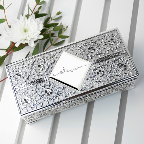 Life is too short to wear boring jewellery!   A beautiful addition to her dressing table, this ornate trinket box is the perfect place to store her most precious jewellery. Lined with black felt her jewellery will be safely protected from scratching & tarnishing. With space for rings, earrings and larger jewellery.  Personalise this jewellery box with a name, up to 12 characters.