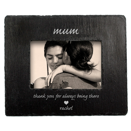 """Natural slate photoframe with a window cut into the stone to display your photo Personalised with up to 2 messages, one above and one below the frame. The """"Thank you for always being there"""" text and heart is fixed. Dimensions: 24cm x 19cm"""