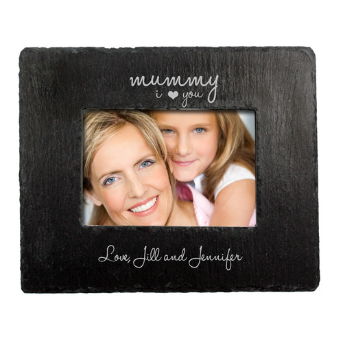 """Natural slate photoframe with a window cut into the stone to display your photo Personalised with up to 2 messages, one above and one below the frame. The """"i heart you"""" text is fixed. Dimensions: 24cm x 19cm"""