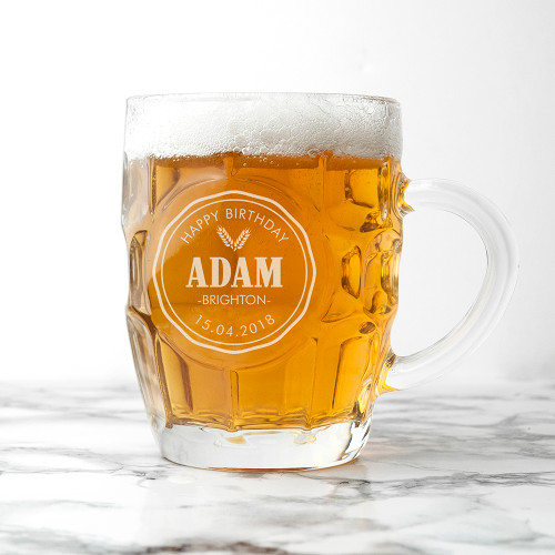 A traditional beer stein that's the perfect gift for him!  Hand etched with a name, and two short messages of your choice.  Made from glass.  Hold's 1 pint (approx)