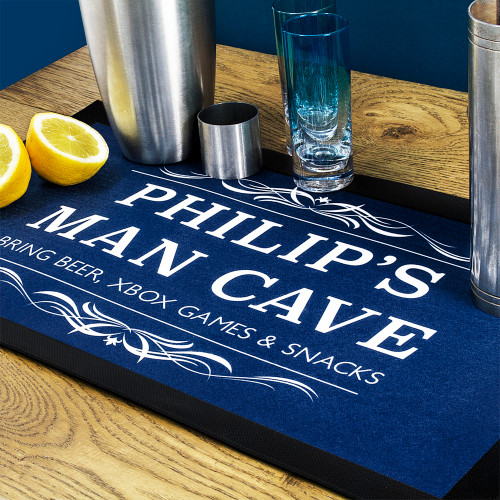 The perfect accessory for the Man Cave, Bar or Inn!  In six different colourways and personalised with both a name, place and a message of your choice, he'll be in Man Cave heaven with this bar mat. Made from rubber this bar mat is nonslip  Fabric top, perfect in case there's any spillages! The ''Man Cave'' doesn't come as a standard.