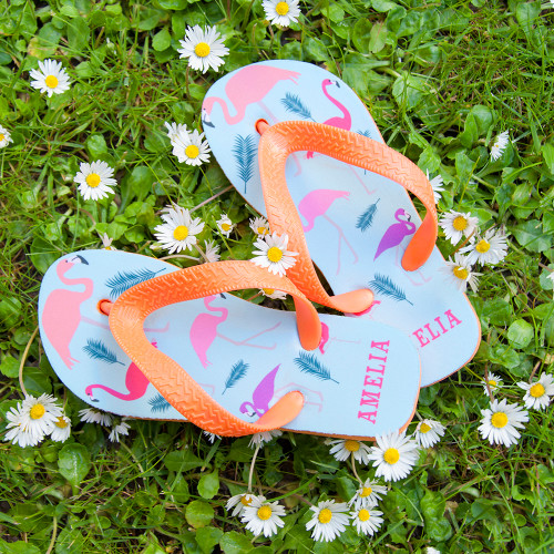 A great gift for your little flamingo!  These fun and vibrant flip flops are perfect for little feet, cushioned soles give extra comfort and flexible straps makes adjusting simple.  These flamingo themed flip flops are both stylish and practical.  Personalise the flip flops with a name on the heel, up to 10 characters.  Please be sure to take note of the length of the flip flops to insure you receive the correct size for your child.  Length of Flip Flops:  Small: 17.5cm  Medium: 19.2cm  Large: 22.5cm