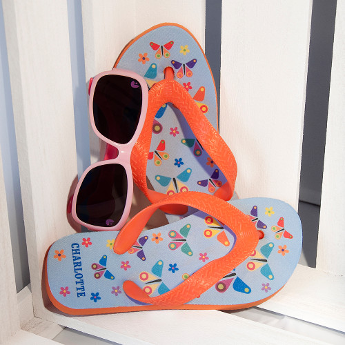 A great gift for your little butterfly!  These fun and vibrant flip flops are perfect for little feet, cushioned soles give extra comfort and flexible straps makes adjusting simple.  These butterfly themed flip flops are both stylish and practical.  Personalise the flip flops with a name on the heel, up to 10 characters.  Please be sure to take note of the length of the flip flops to insure you receive the correct size for your child.  Length of Flip Flops:  Small: 17.5cm  Medium: 19.2cm  Large: 22.5cm