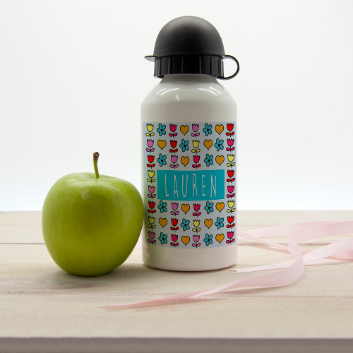 Heart and flowers - what more could a little girl want for their water bottle?!  In a choice of six vibrant and fun colourways your little one will be sure to find a colour they love! Dishwasher safe Holds 400ml of liquid Made from aluminium with sports cap  Personalise with a name.