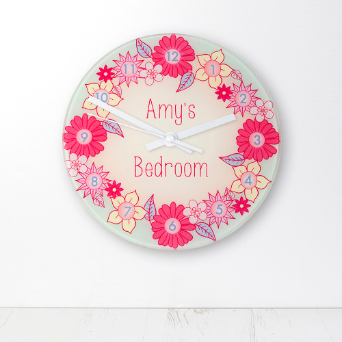 Flowers? Check Pink? Check Wreath? Check Adorable? Check  That's right, we've made the most girly, prettiest clock imaginable!  This 20cm glass wall clock is great to hang in their bedrooms.  Personalise with a name up to 15 characters.  The word 'Bedroom' comes as standard.