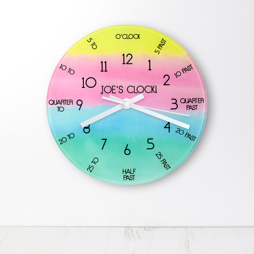 It's incredibly important for children to learn how to tell the time, it takes practice and patience. We've made it easy and most importantly fun for children to learn. In vibrant watercolour and with easily broken down segments children are able to dissect the time with ease.  This 20cm glass wall clock is great to hang in their bedrooms.  Personalise with a name up to 15 characters.   The word 'Clock' comes as standard.