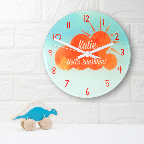 For your little ray of sunshine!  This adorable clock will fit in any little one's room or nursery.  This 20cm glass wall clock is great to hang in their bedrooms.  Personalise with a name up to 15 characters.  The words 'Hello sunshine!' come as standard.