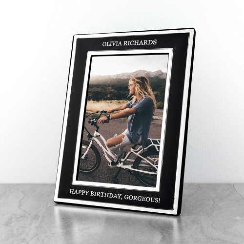 This stylish matte black photo frame with silver plated edging is a wonderful gift to treasure for years to come. Personalise with two lines of text, one at the top of the photo and the other at the bottom.  Fill the frame with a photo to make them smile.  The frame fits photos 4x6 inches (10cm x 15cm)