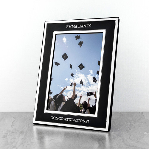 There's no prouder moment in a parent's or grandparent's life than seeing your child succeed in something they have worked so hard to complete.  This stylish matte black photo frame with silver plated edging is a wonderful gift to treasure for years to come. Personalise with two lines of text, one at the top of the photo and the other at the bottom.  Fill the frame with a photo of their special day.  The frame fits photos 4x6 inches (10cm x 15cm)
