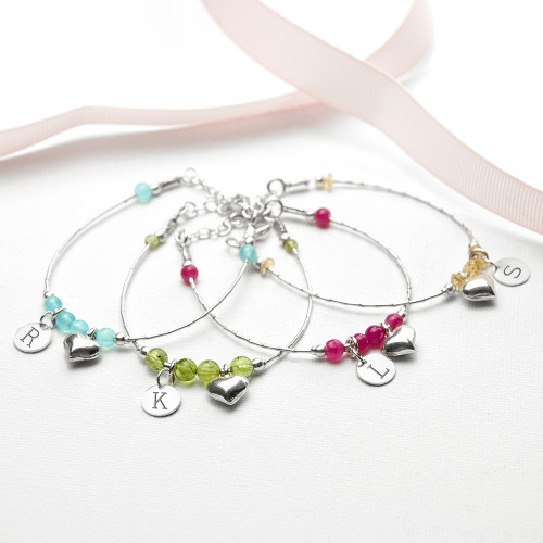 The love between a mother and daughter is forever'  This thoughtful and sentimental bracelet for a child is a wonderful gift for for her. Whether it be a gift for a birthday, baptism or Christmas.  Made from stamped 925 sterling silver this charm bracelet is handmade and beautiful. With a delicate heart charm and a choice of four different semi precious gemstones the bracelet is the perfect thoughtful gift.  The bracelets have a total of four different charms, both with space for personalisation. The detailed heart charm adds softness and symbolises the heart both mum and baby once shared. The brightly coloured gemstones add a splash and depth of colour.