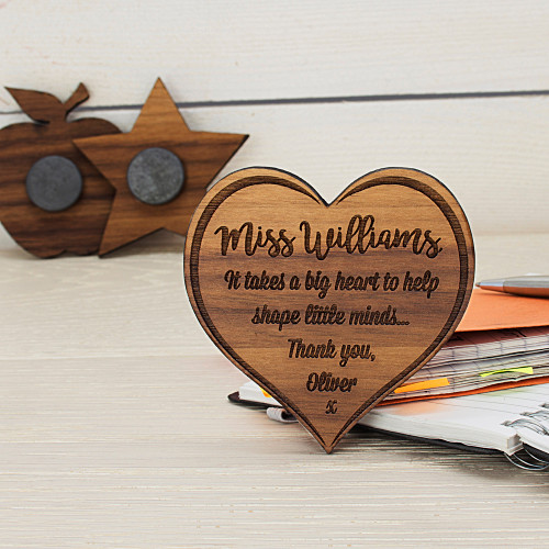 A wonderful gift for your favourite teacher!  Made from beautifully crafted walnut wood and engraved with the teacher's name and a message, this magnet is sure to take pride of place on their fridge.  In the shape of a heart and designed with a darkend boarder which adds depth to the design as well as extra detail. Made from Walnut Wood Engraved with a name and message Perfect thank you teacher gift