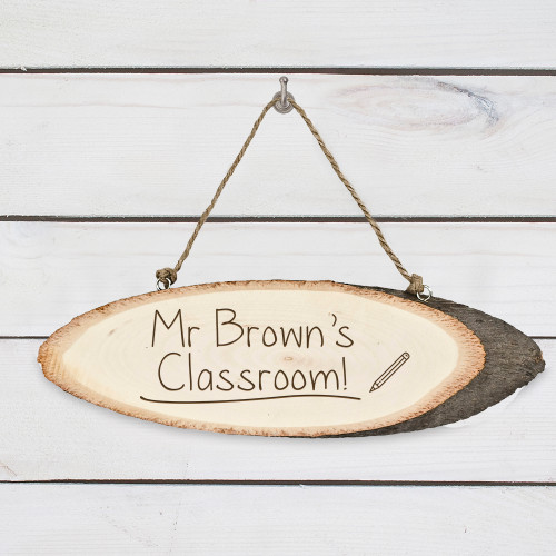 A great gift for a new teacher, or as a thank you gift for their favourite teacher.  Personalise with the name of the teacher. Made from birch wood and hung with a rustic woven cord. The word 'Classroom' comes as standard text Please be sure to write the teacher's name exactly as you'd like to recieve the sign, for example; Mr Thomas', Mrs Kent's
